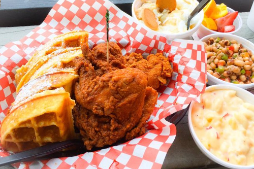 Chicken and Waffles served with mac and cheese with banana pudding for dessert.