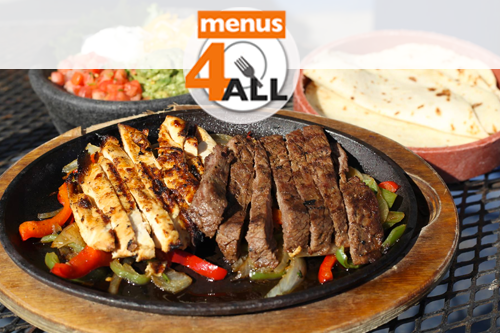 Chuey's beef and chicken fajitas, with guacamole, sour cream, and cheese,