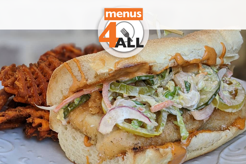 Fried North Carolina Flounder Po Boy with Cajun remoulade, coleslaw, pickled green tomatoes and bread and butter pickles on a toasted hoagie roll from Haywood Common.